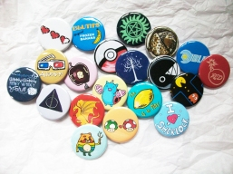 Physical buttons with various pop culture designs
